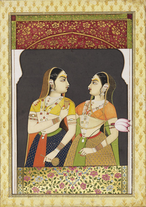 Two girls in an archway with a curtain