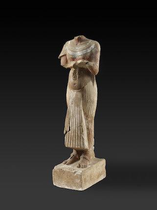 Figure of Pharaoh Akhenaten holding an offering table