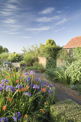 The Farmhouse Garden in summer at RHS Garden Hyde Hall.