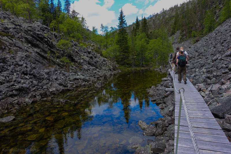 Guided easy hike to Finland deepest gorge to holy baptism… | Luosto