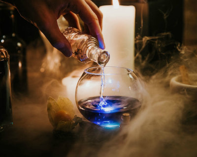 The Cauldron making blue cocktail