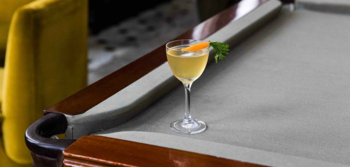 The Lobby Bar Shakes Up a New Cocktail Menu with cocktail on a billiard table Menu