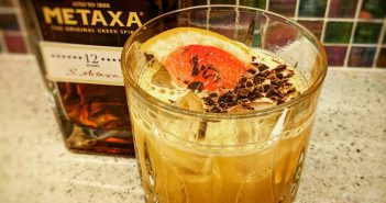 Metaxa cocktails with bottle and cocktail glass