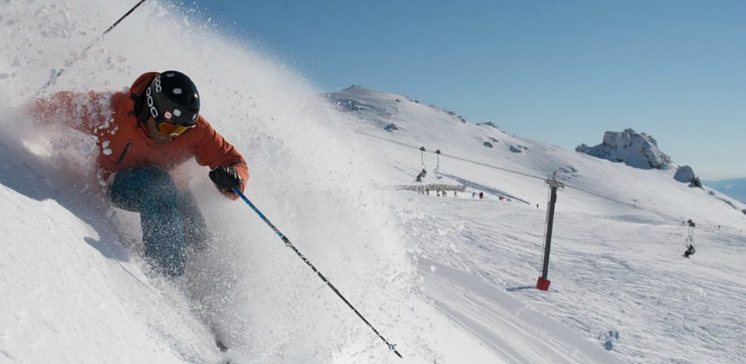 Cardrona Alpine Resort with skier hitting slopes fast