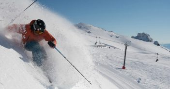 Cardrona Alpine Resort with skier hitting slopes fast