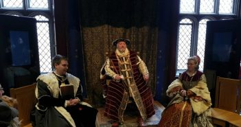 Hampton Court Palace with actors playing the role of Henry VIII and his wife