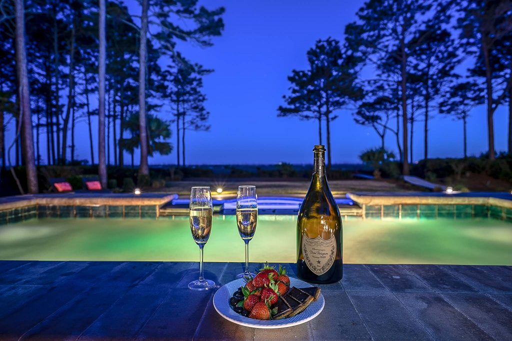 Hilton Head luxury home evening with wine and dinner overlooking the pool