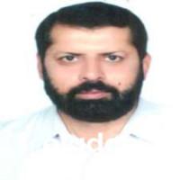 Top dentist in Faisalabad - Dr. Muhammad Farooq Azam