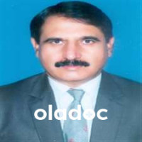 Top dentist in Faisalabad - Dr. Muhammad Iqbal
