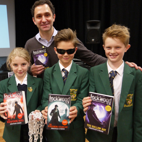 Jonathan Stroud is pictured with Yasmin Boxall, Tane Bruce Wallis and Charlie Brady … complete with ghost hunting apparel and copies of the Lockwood & Co. books.