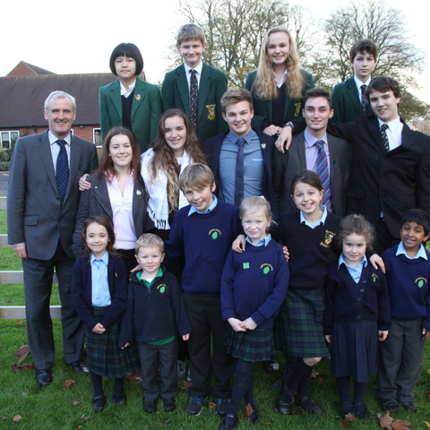 Head Michael Goodwin is pictured with some of Sibford's pupils