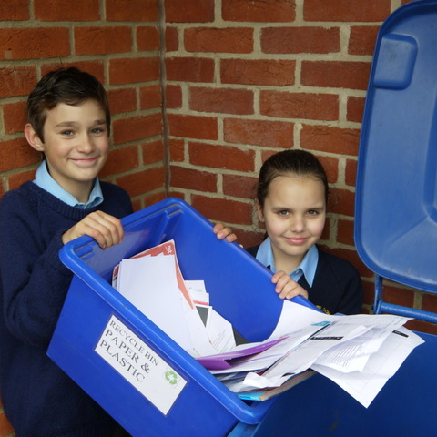 10-year-olds Tennison Witherford and Sofia Nycander Calnan undertake their first good deed … emptying the recycling bin.