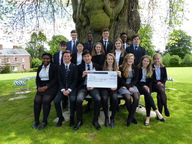 Sixth Form OsBiz Members with Daren Guan and Victoria Raffle presenting the cheque