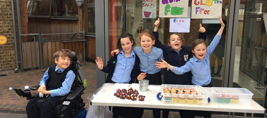 Year 4 children helping with the Hornsby House School cake sale in aid of Little Village