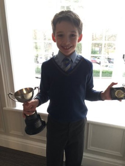 Oliver shows his trophies from U12 Foils competition