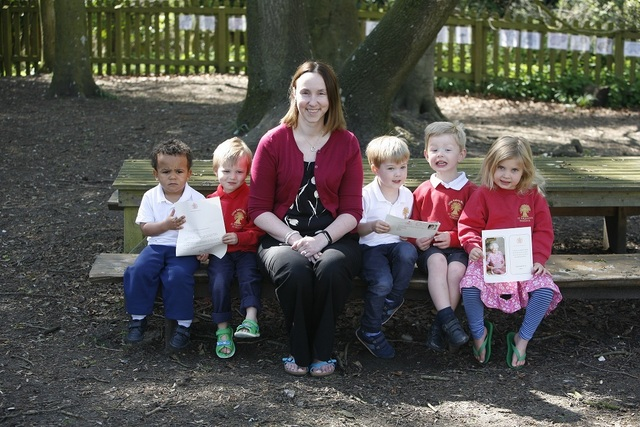 1Little Saints Nursery pupils with Room Leader, Mrs Lisa Cox show the letter and card from Buckingham Palace
