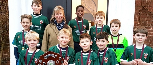 The victorious squad: Top (L-R) George Kilburn, Daniel Halkon, Mrs Thacker, Drew Chikosi, Oliver Shelton, Angus Pepperall. Bottom (L-R) Harvey Shaw,