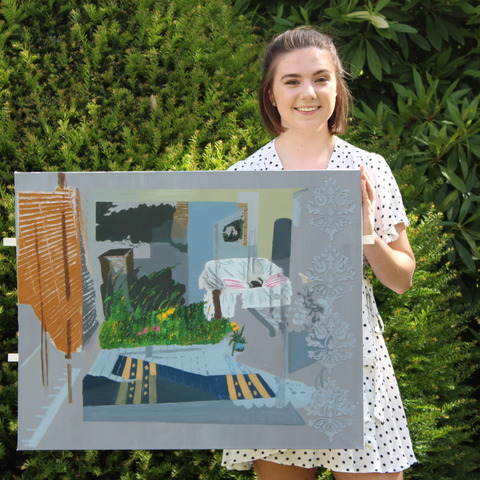 Evie with her winning Artwork