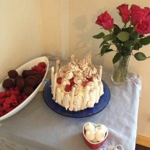 Vanilla and strawberry sponge with meringue and cream.