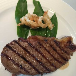 Sirloin Steak, with french fired onions and wild garlic leaves.