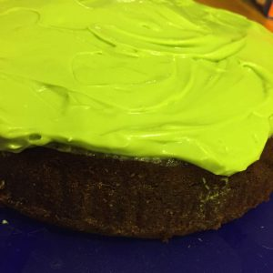 A rather luminous green iced stout cake