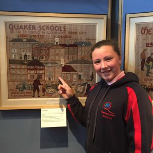 Jordan pointing out Newtown on the Quaker Tapestry