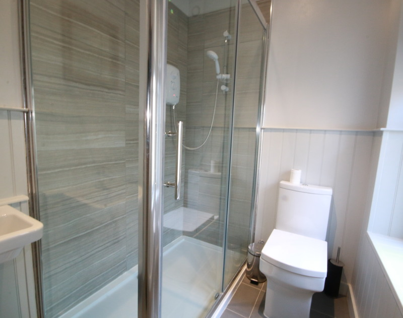 A contemporary shower room in Westray House, a self catering holiday rental by the sea in Polzeath, North Cornwall.