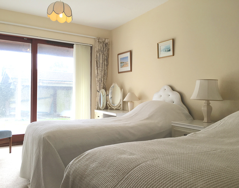 One of three twin bedrooms on the ground floor at Chy An Fos, a self catering holiday house to rent in Rock, Cornwall.