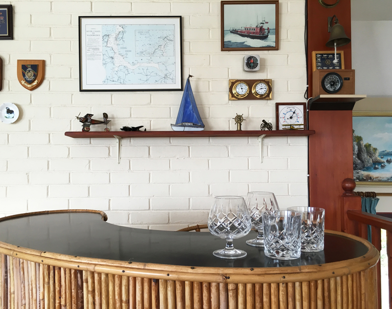 The bar in the living room at Chy An Fos, a self catering holiday house to rent, set above the Camel Estuary in Rock, North Cornwall.
