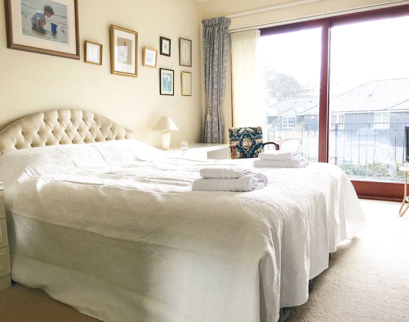 The bright, master bedroom in Chy An Fos, a self catering holiday rental in Rock, Cornwall.