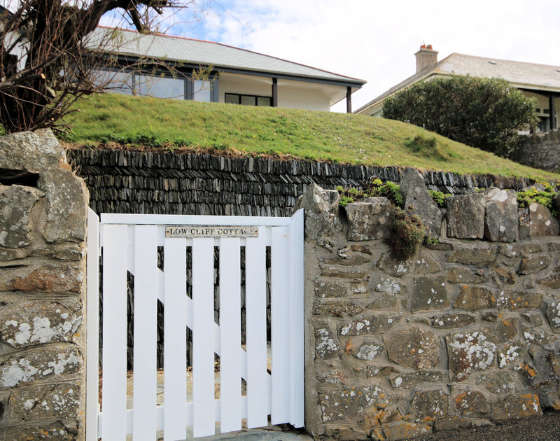 Access the beach via the garden gate at Low Cliff Cottage, a seaside holiday house in Polzeath, Cornwall