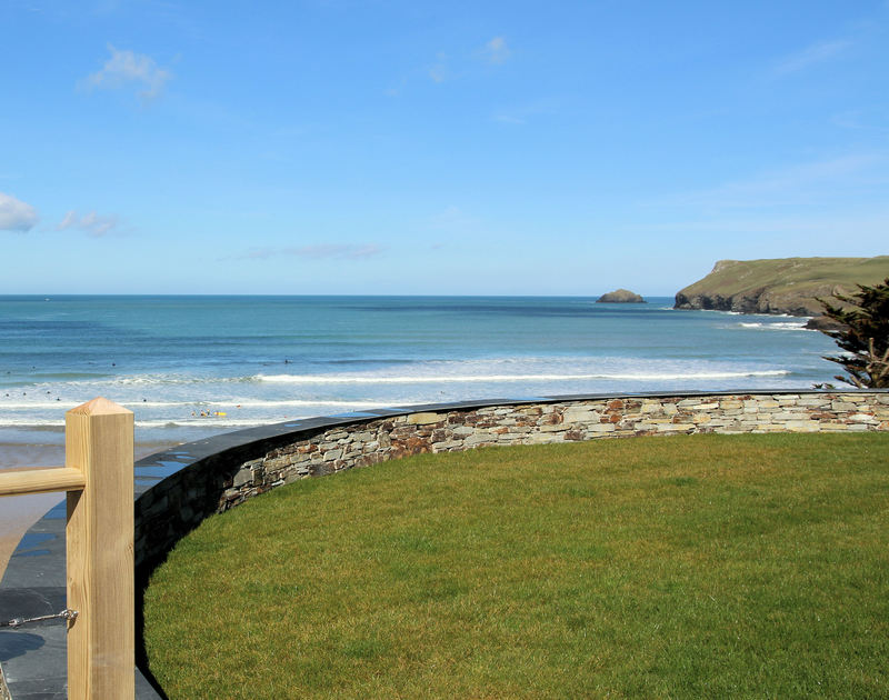 Enjoy the uninterrupted views of the sea, Newland, and Pentire Point from the lawned garden at The White House set on the cliffs at New Polzeath in North Cornwall.
