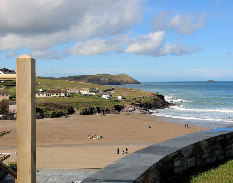 The views across Polzeath Beach towards Stepper Point from the ideally located holiday rental The White House in New Polzeath, Cornwall.