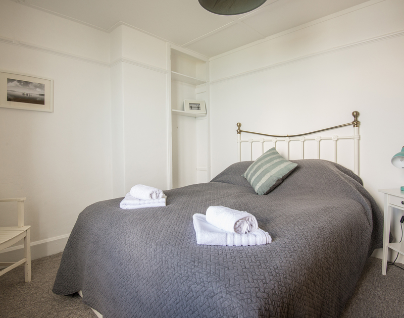 A king size  bedroom with stunning sea views at Signal Post, luxury self catering holiday accommodation set between Pory Gaverne and Port Isaac in North Cornwall.
