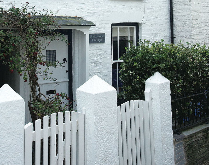 Brakestone Cottage in Port Isaac is an attractively whitewashed cottage with stable door and picket fence gate.