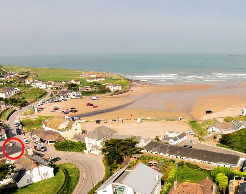 An aerial view of the stunning beachside location of Flat 1, The Parade, a holiday apartment at Polzeath, Cornwall