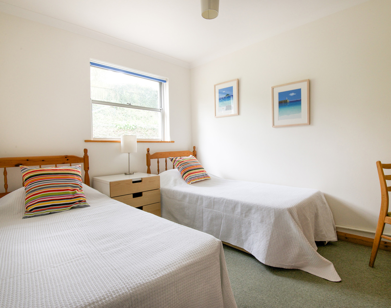 The first of two twin bedrooms in Slipway 15, a self catering holiday cottage to rent in Rock, North Cornwall.