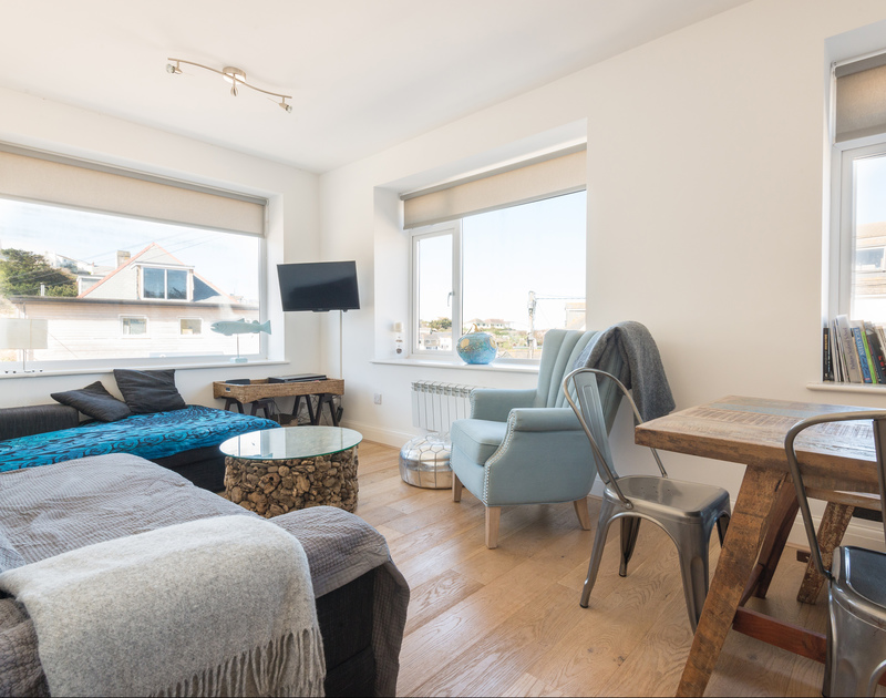 Comfortable open plan sitting room at Flat 1, The Parade, a holiday apartment to rent in Polzeath, Cornwall