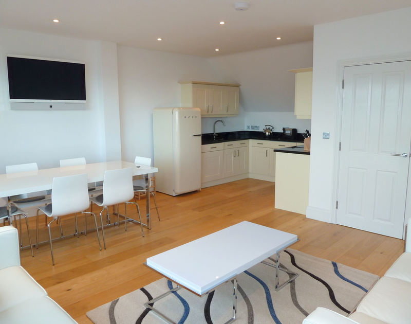 Stylishly furnished open plan kitchen/dining/sitting room in self catering holiday house The Saltbox in Port Isaac, North Cornwall.
