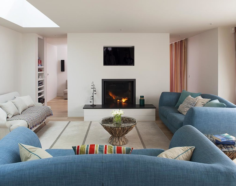 Stylish and comfy sitting room of Downalong, an architect-designed holiday house at Daymer Bay, Cornwall