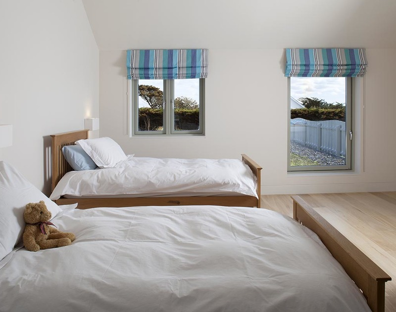 The twin bedroom at Downalong, a stunning holiday house to rent at Daymer Bay, North Cornwall