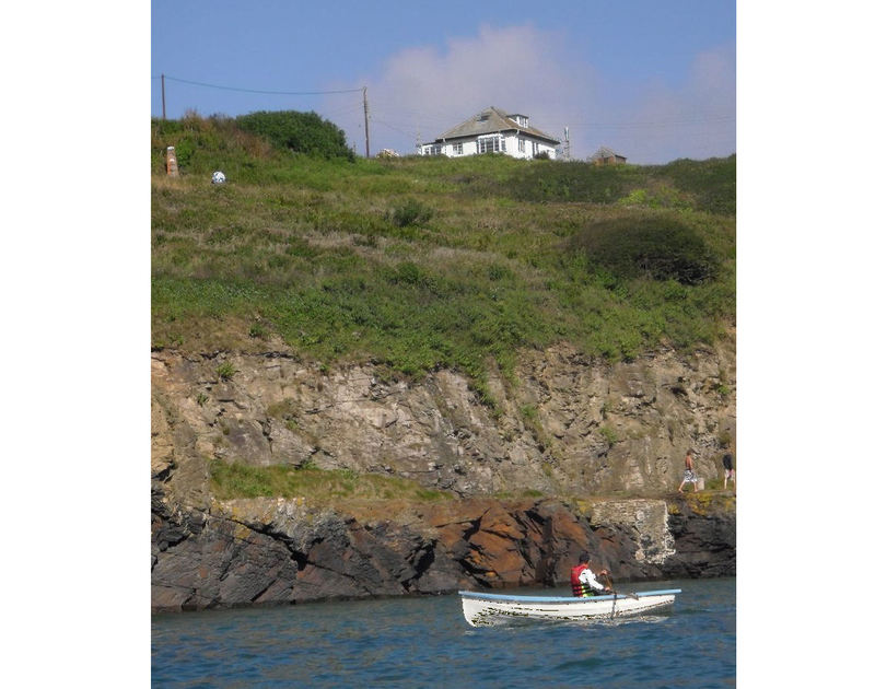 Picture taken from a boat on the water in Port Gaverne of Cartway Cove, a self catering holiday cottage in Cornwall