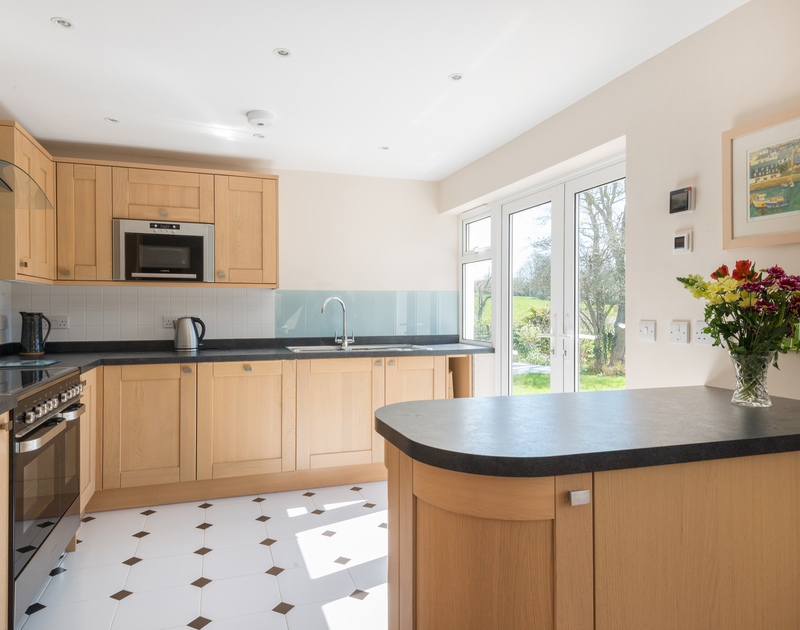 The contemporary kitchen in Chy-An-Dowr, a stylish holiday retreat to rent in Rock, North Cornwall.
