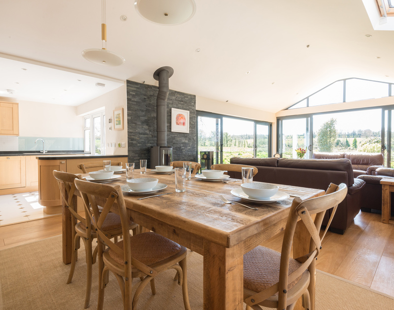 The spacious dining room in Chy-An-Dowr, a contemporary self catering holiday house to rent in Rock, North Cornwall.