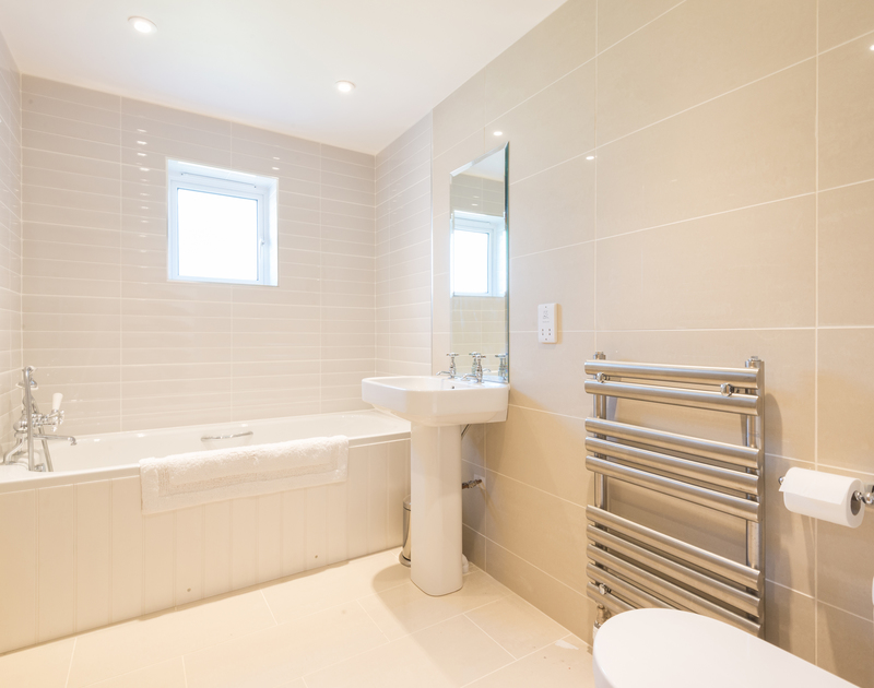 One of two bright bathrooms in Chy-An-Dowr, a stylish and contemporary holiday rental in Rock, Cornwall.