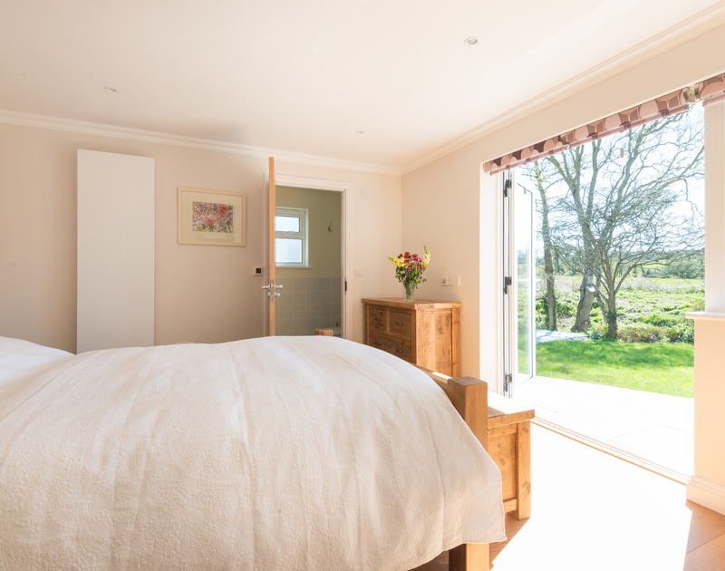 The light filled master bedroom at Chy-An-Dowr, a self catering holiday house to rent in Rock, North Cornwall.