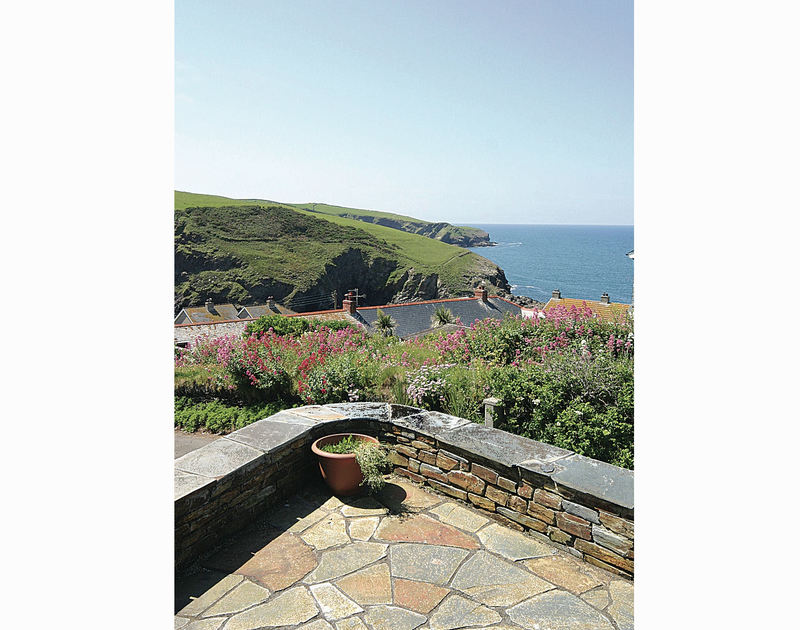 Sea and coastal views from the front patio at holiday rental Shilling Stones in Port Isaac, Cornwall.