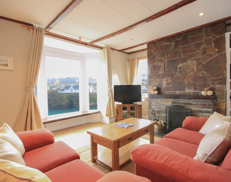 Cosy, bright sitting room with seaviews at Northcliffe Garden Flat, a holiday apartment in Port Isaac.