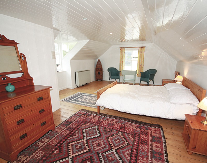 Spacious, top floor double bedroom of Quay Cottage, a harbourside holiday house in Port Isaac.