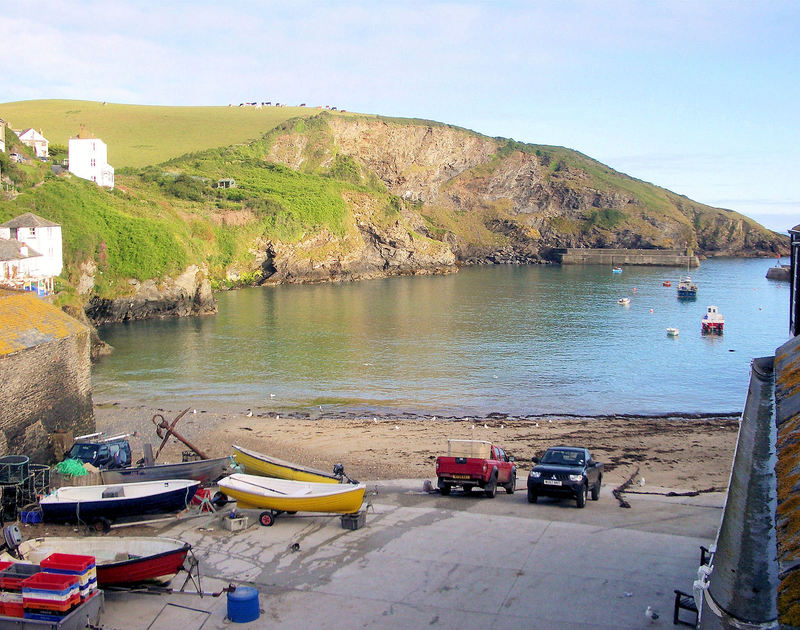 View of Port Isaac's working fishing harbour from Quay Cottage, a self-catering holiday rental in Port Isaac, Cornwall